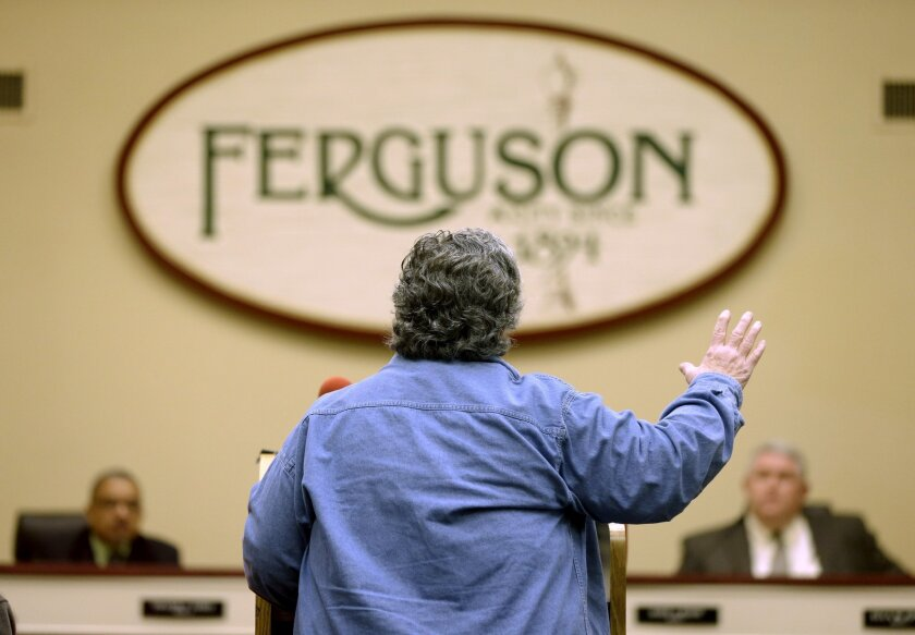 Gerry Jasper speaks in favor of an agreement with the U.S. Department of Justice during a city council meeting Tuesday, Feb. 2, 2016, in Ferguson, Mo. The meeting was the first opportunity for residents to speak directly with city leaders following a preliminary consent agreement with the Justice D
