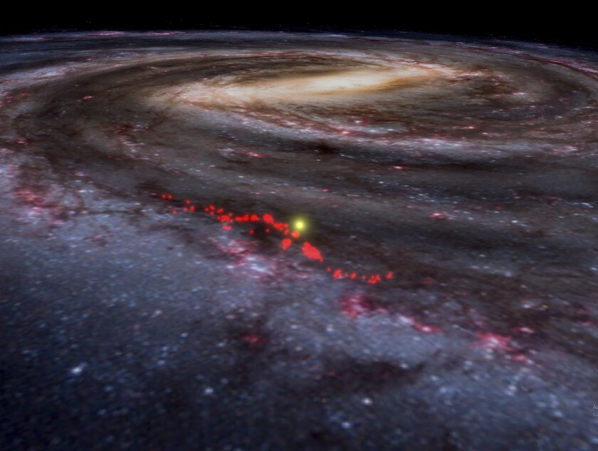 """This illustration provided by Harvard shows data from the """"Radcliffe Wave,"""" indicated in red, superimposed on an artist's rendering of Milky Way galaxy. On Tuesday, Jan. 7, 2020, scientists reported that this massive structure of star-forming gases was discovered in the galaxy's spiral arm closest to Earth. (Alyssa Goodman/WorldWide Telescope via AP)"""