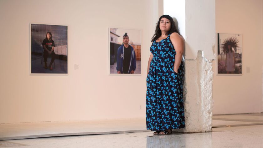 Photographer Star Montana stands amid her work at the Main Museum in downtown Los Angeles.