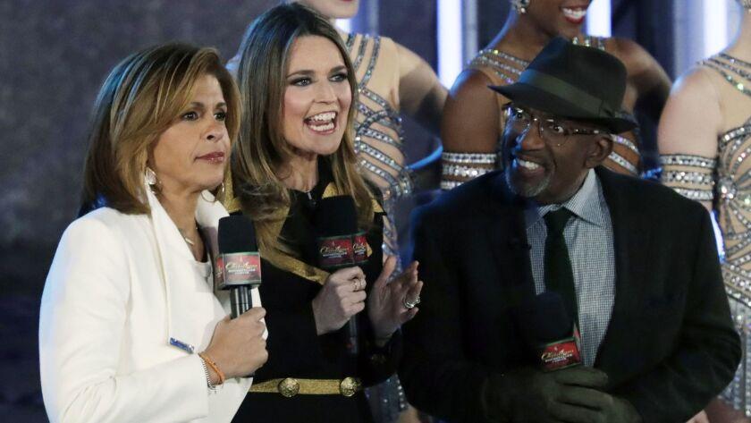 """Today"" regulars Hoda Kotb, Savannah Guthrie and Al Roker host the NBC broadcast of the 85th annual Christmas tree lighting ceremony at Rockefeller Center in New York City on Nov. 29."