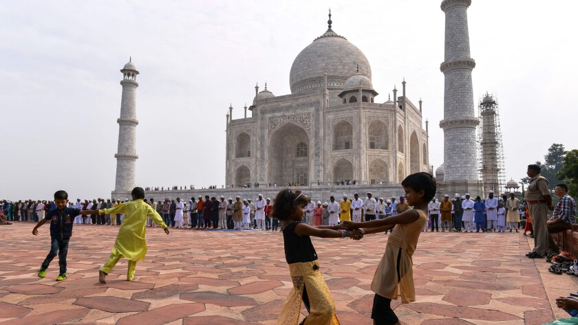 Children play in front of the Taj Mahal in Agra, India, last month.