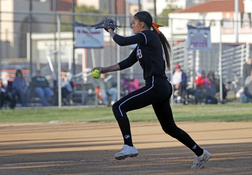 Huntington Beach High pitcher Grace Uribe throws during the first inning against Los Alamitos in a S