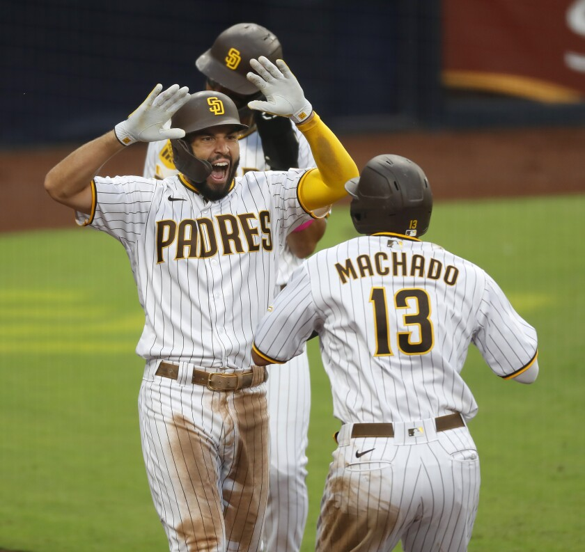 Eric Hosmer of the San Diego Padres celebrates with Manny Machado after hitting a grand slam in the fifth inning Thursday.