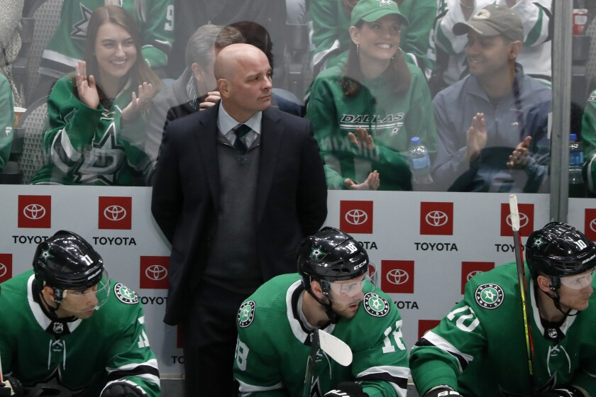 Dallas Stars head coach Jim Montgomery, Andrew Cogliano (11), Jason Dickinson (18) and Corey Perry (10) watch play against the Vegas Golden Knights in the third period of an NHL hockey game in Dallas, Monday, Nov. 25, 2019. The Stars won 4-2. (AP Photo/Tony Gutierrez)