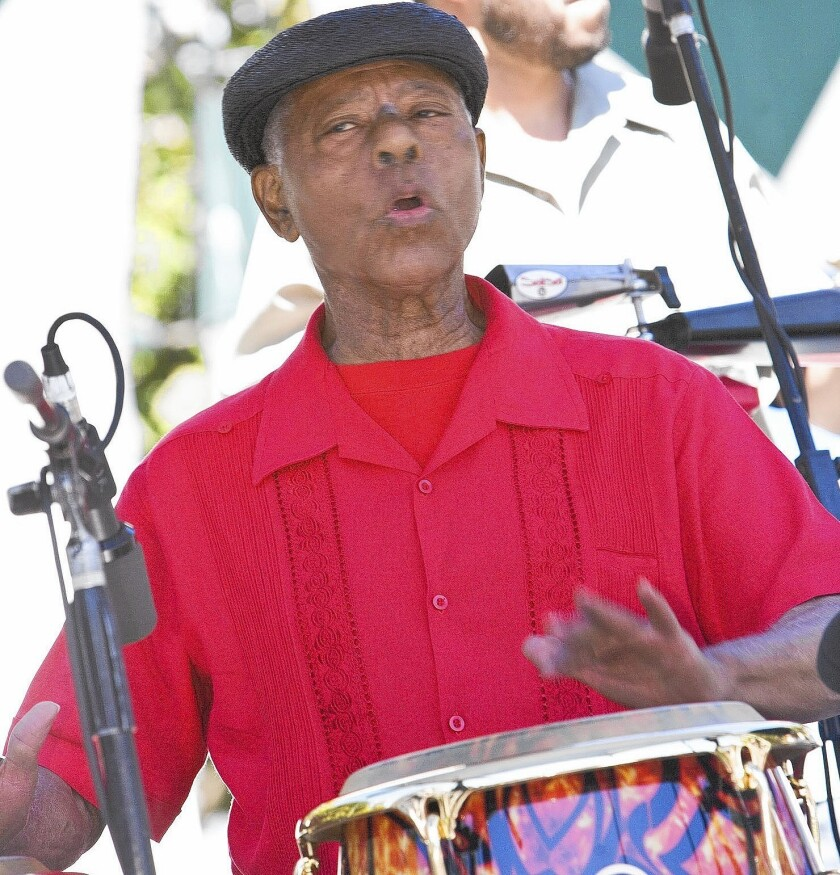 """Armando Peraza performs at Yerba Buena Gardens in San Francisco in 2007. """"When he played, he would move his hands in a dramatic fashion in dance-like moves,"""" said John Santos, a San Francisco bandleader."""