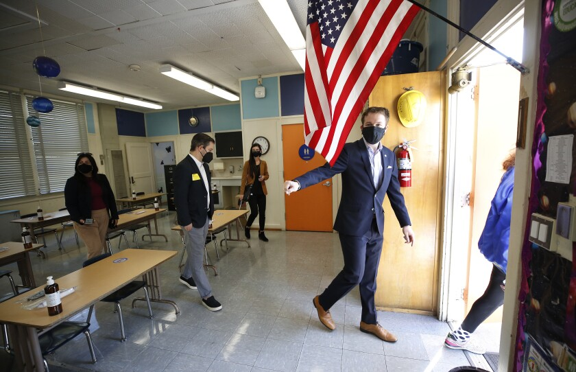 L.A. school board member Nick Melvoin walks out of a classroom.