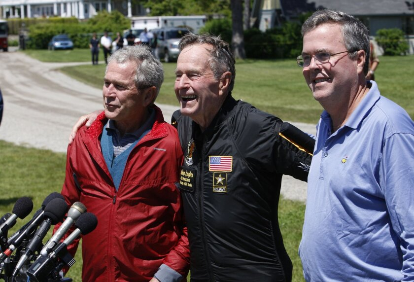 The two George Bushes, at left and center in this 2009 file photo, went unmentioned in Jeb Bush's foreign policy speech Tuesday.