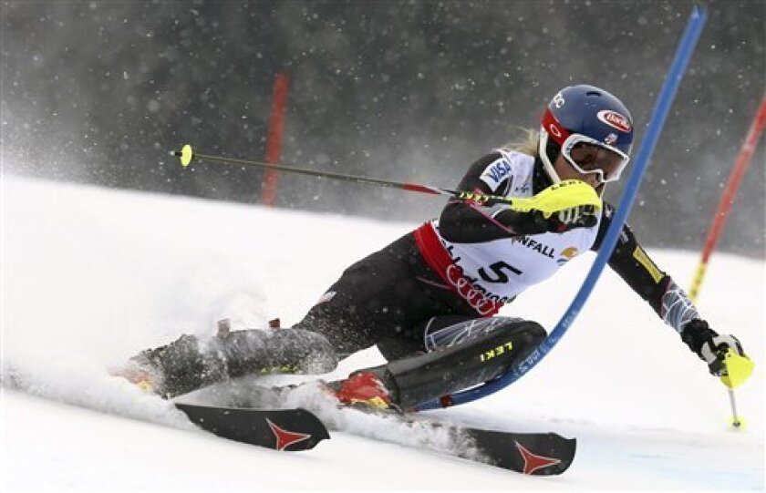 United States' Mikaela Shiffrin clears a gate during the first run of the women's slalom, at the Alpine skiing world championships in Schladming, Austria, Saturday, Feb.16, 2013. American teenager Mikaela Shiffrin became the youngest women's slalom world champion in 39 years on Saturday. (AP Photo/Alessandro Trovati)