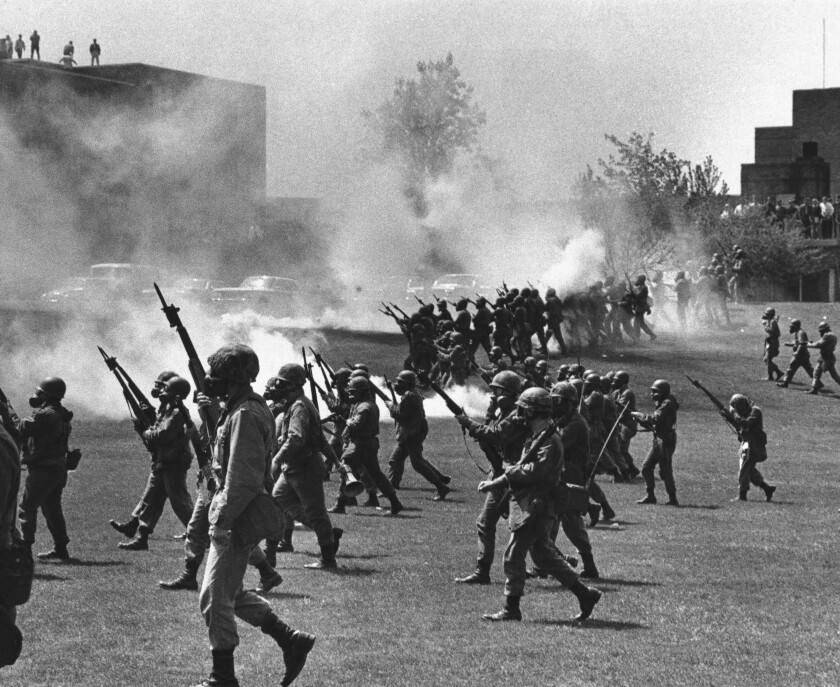 Ohio National Guard troops move in on protesting students at Kent State University on May 4, 1970.