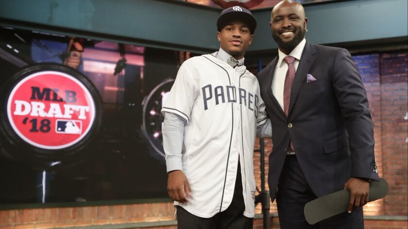 Xavier Edwards, a shortstop from North Broward Preparatory High School in Florida, poses for photographs with Tony Gwynn Jr. after being selected No. 38 by the San Diego Padres during the first round of the Major League Baseball draft Monday, June 4, 2018, in Secaucus, N.J.