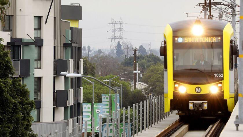 CULVER CITY-CA-JANUARY 3, 2017: A Metro train passes by apartments in Culver City on Wednesday, Janu