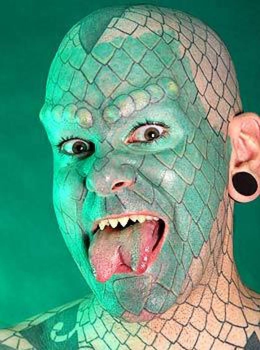 Erik Sprague performs as Lizardman.