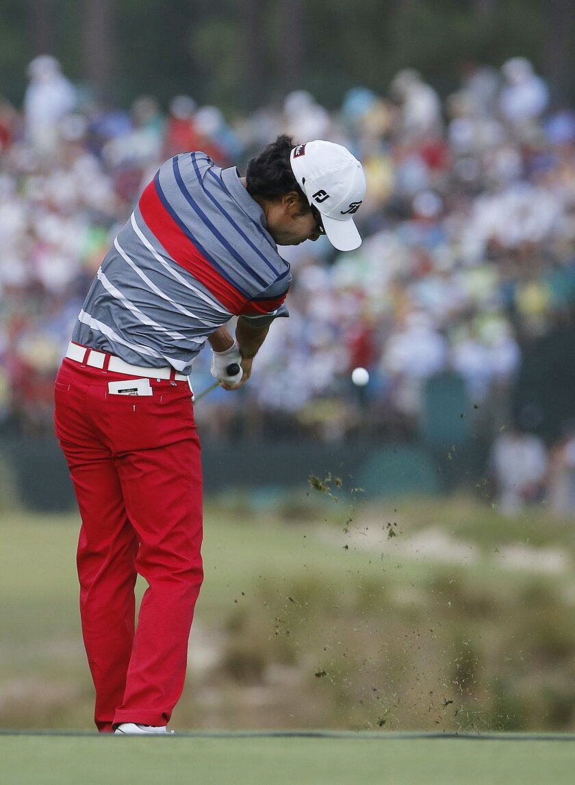 Kevin Na hits his tee shot on the 17th hole during the first round of the U.S. Open golf tournament in Pinehurst, N.C., Thursday, June 12, 2014. (AP Photo/Matt York)