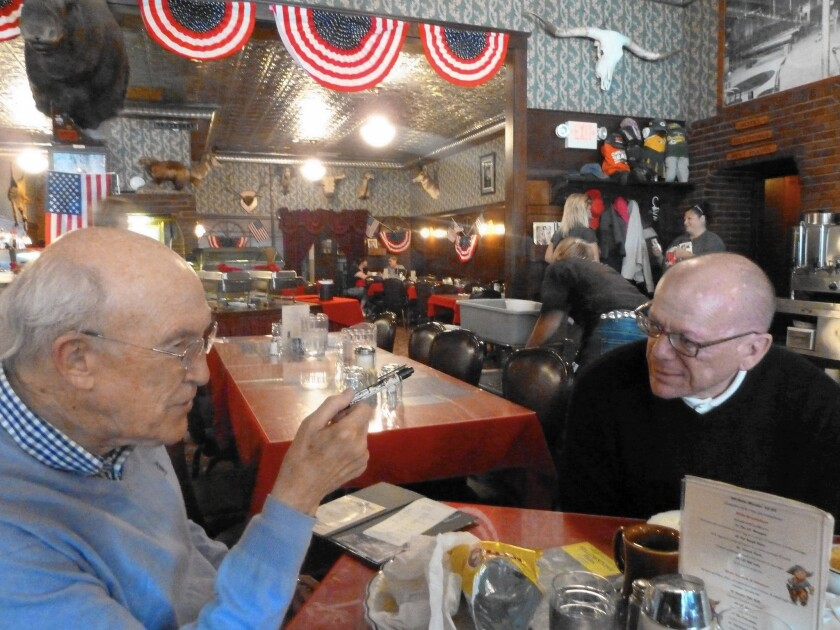 A reluctant Gregory Hinton returned to visit Wyoming after being encouraged by retired GOP Sen. Alan K. Simpson, left. Now they are friends.