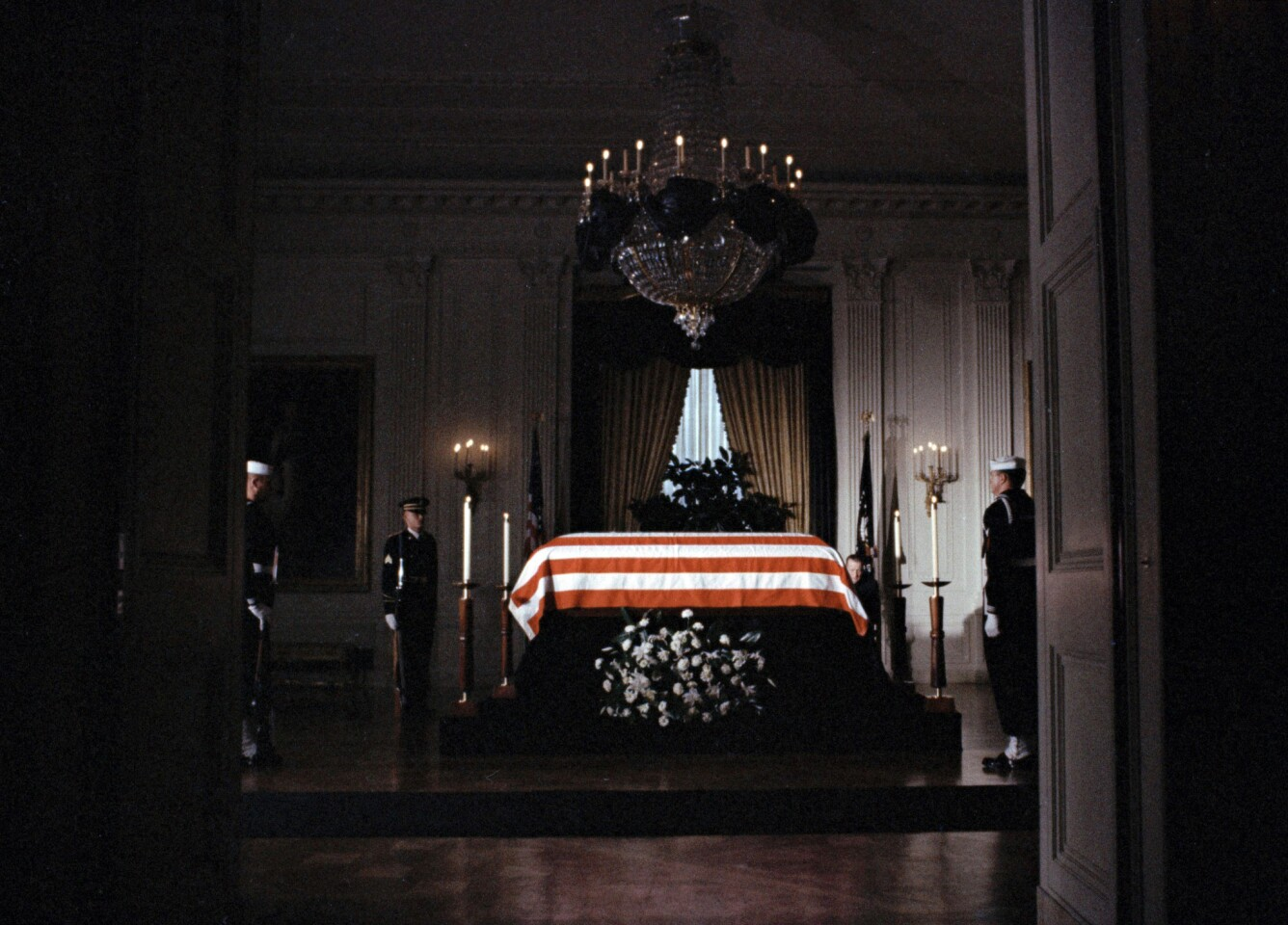 The flag-draped casket of President John F. Kennedy lies in state in the East Room of the White House in Washington.