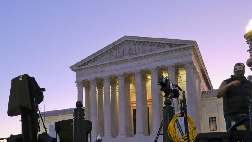 News crews setup outside of the Supreme Court early Monday morning, Oct 2. 2017, in Washington, on t
