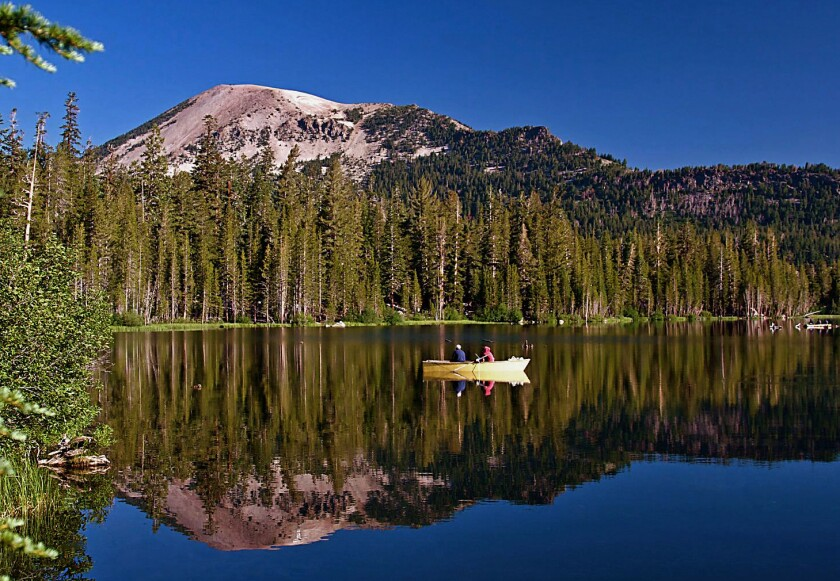 Mammoth Lakes are the surrounded area is a population destination for angles like these fisherman in a boat.