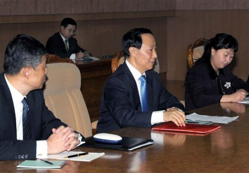 In this photo released by Korean Central News Agency via Korea News Service in Tokyo, senior Chinese Communist Party envoy Wang Jiarui, center, meets with North Korean leader Kim Jong Il, unseen, in Pyongyang, North Korea, on Monday, Feb. 8, 2010. Wang was in North Korea on a mission to persuade the reclusive state to rejoin nuclear disarmament talks, reports said. (AP Photo/Korean Central News Agency via Korea News Service)