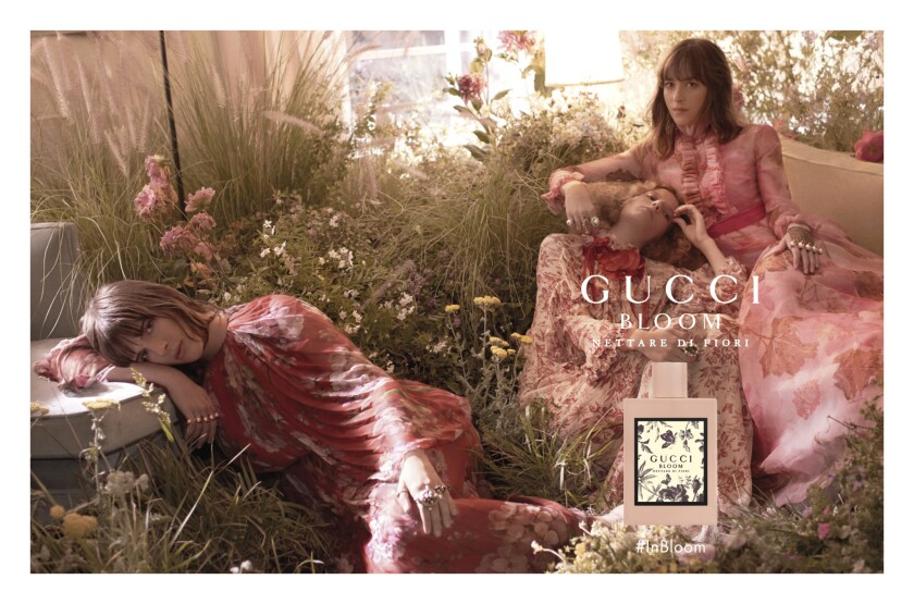 Dakota Johnson appears alongside Hari Nef and Petra Collins in Gucci's fragrance campaign for Gucci