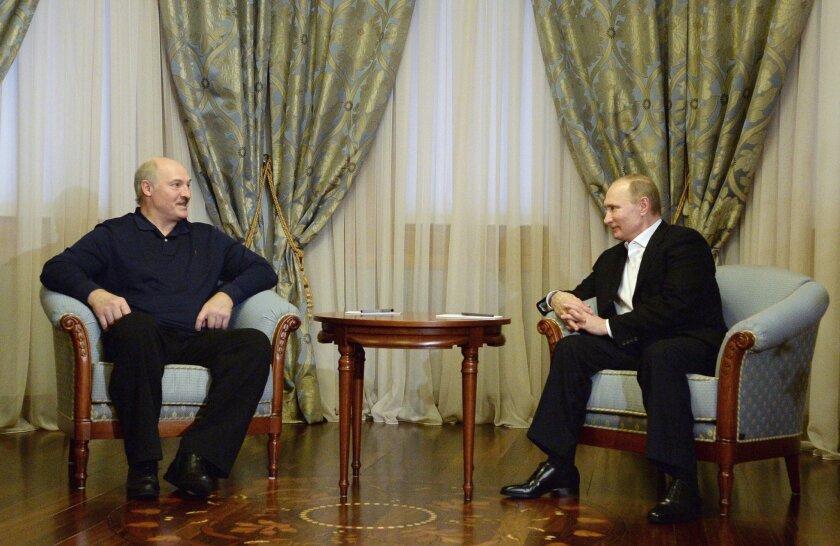 Russian President Vladimir Putin, right, meets with Belarusian President Alexander Lukashenko in the Bocharov Ruchei residence in the Black Sea resort of Sochi, Russia, Friday, Feb. 5, 2016. (Sputnik, Kremlin Pool Photo via AP)