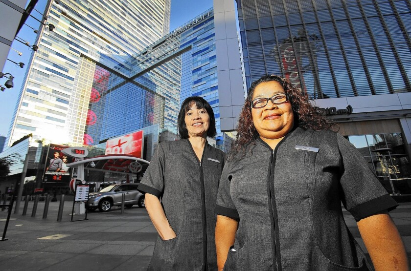 Rosario Alfaro, left, and Sonia Rosales are housekeepers at the JW Marriott hotel at L.A. Live.