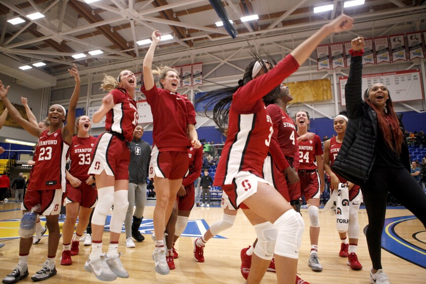 Stanford celebrates winning the championship over Mississippi State 67-62 at the Greater Victoria Invitational championship NCAA college basketball game in Victoria, British Columbia, Saturday, Nov. 30, 2019. (Chad Hipolito/The Canadian Press via AP)
