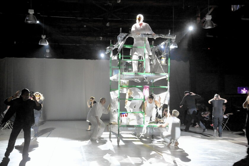 """The Poet (Michael Shamus Wiles) rises above the acolytes in Long Beach Opera's """"Hydrogen Jukebox"""" in San Pedro."""