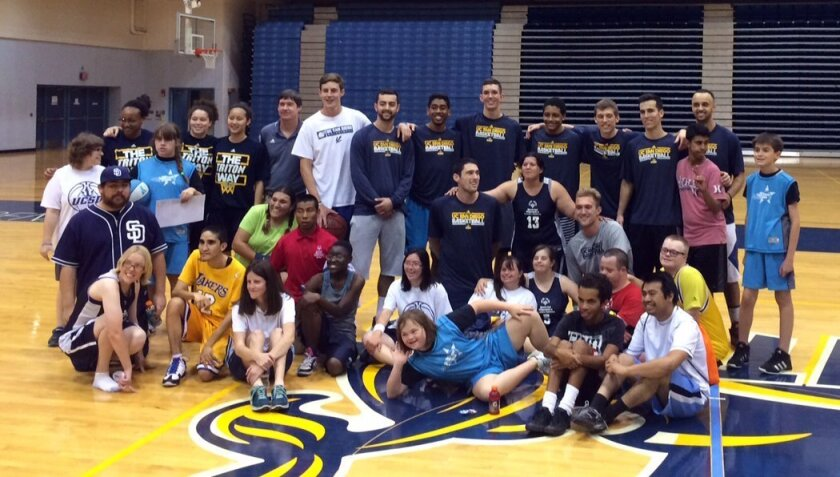 UCSD's men's and women's basketball teams conducted a clinic for a local Special Olympics group.