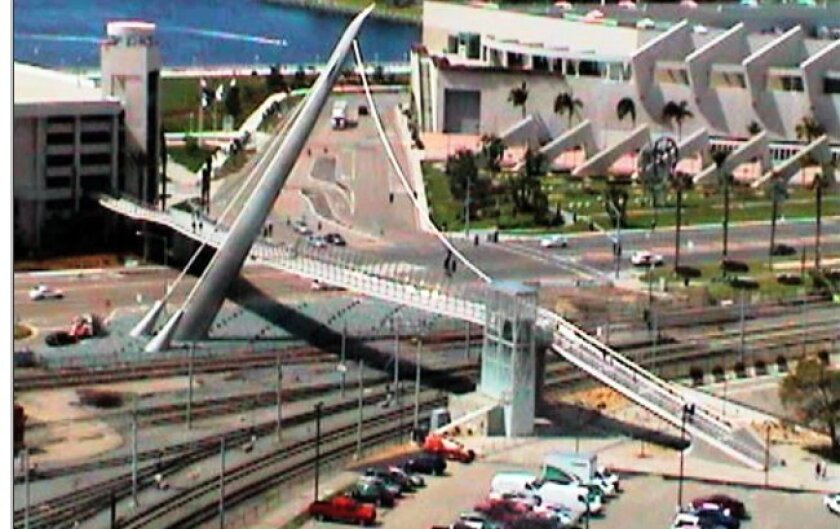 The pedestrian bridge at the foot of Park Boulevard was a key element of the Bay-Park Link planned to link San Diego Bay with Balboa Park. But budget cutbacks may delay completion of the landscaping of this key stretch downtown.