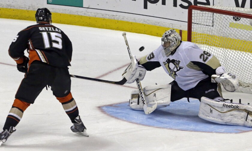 Ducks forward Ryan Getzlaf shoots wide of the net in front of Pittsburgh Penguins goalie Marc-Andre Fleury during the shootout portion of the Ducks' 3-2 loss Friday. The Ducks recently have struggled in shootouts.