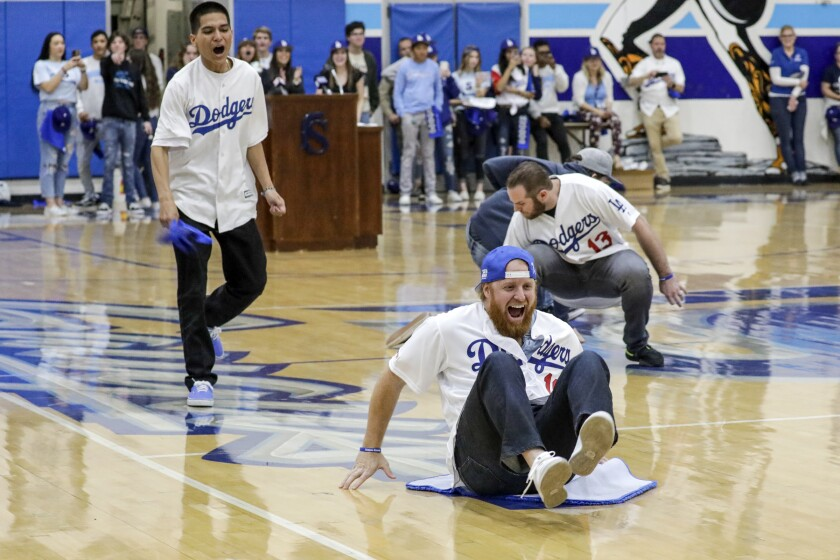 Dodgers third baseman Justin Turner plays a game while visiting Saugus High School with his teammates on Friday.