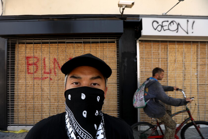 Bobby Kim, co-owner of the Hundreds, in front of the boarded-up establishment in the Fairfax District on June 3.