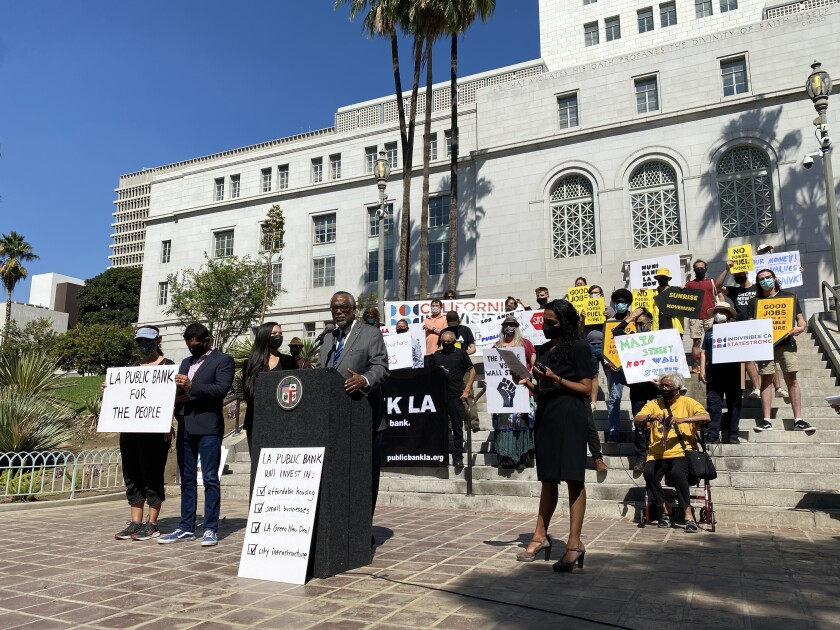 L.A. City Councilman Curren Price speaks outside City Hall