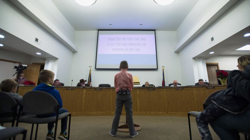 Range View Elementary School third grader Dane Best presents his argument to town board trustees to