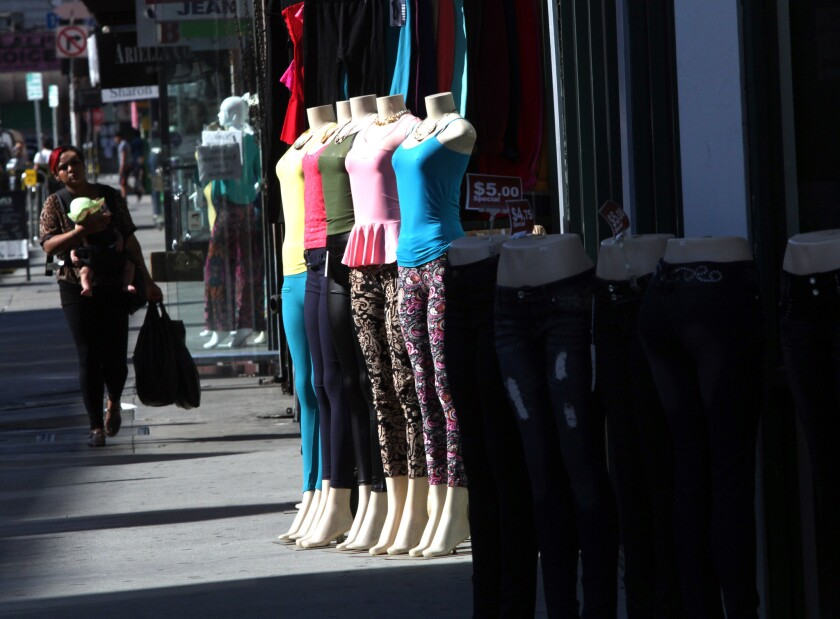 """Sidewalk displays in Los Angeles downtown fashion district. Federal agents hand-delivered """"geographic targeting orders"""" to some business owners in the area on Thursday."""