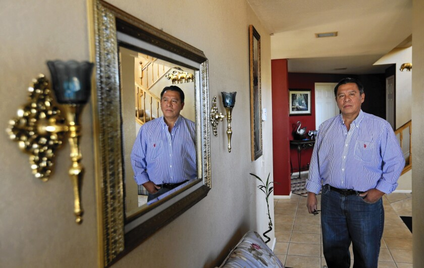 Jesus Sequeira, whose income plunged after his wife died, is fighting to save his Canyon Country home. But there's a glitch: Even though he was listed on the title, only his wife was on the mortgage note.