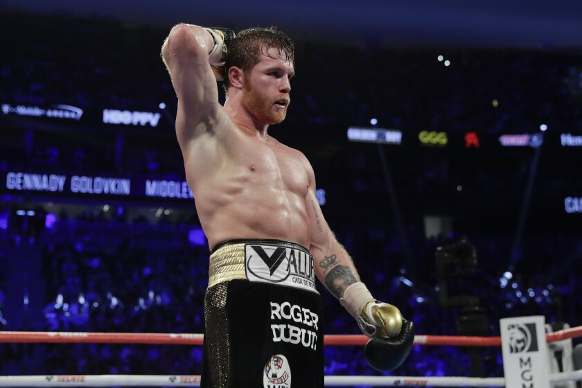 Canelo Alvarez reacts after a middleweight title boxing match against Gennady Golovkin, Saturday, Sept. 15, 2018, in Las Vegas.