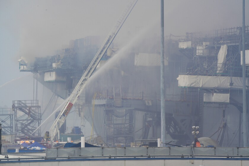 A cloud of smoke enshrouded the Bonhomme Richard at San Diego Naval Base after a five-day fire in July.