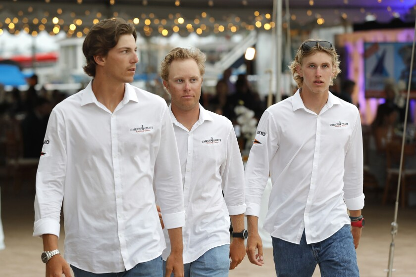 Balboa Yacht Club skipper David Wood, Max Mayol and Daniel Pegg, left to right, arrive at the Governor's Cup banquet.