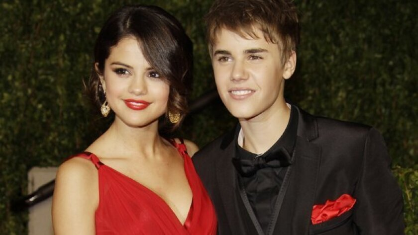 Selena Gomez, who performs in San Diego Friday, and Justin Bieber. Is everything not what it seems?