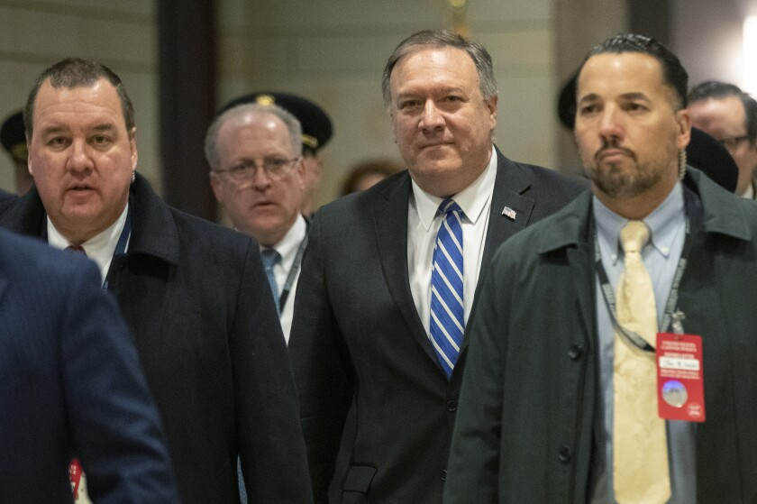 Secretary of State Mike Pompeo, walks towards the Senate after briefing members of Congress on last week's targeted killing of Iran's senior military commander Gen. Qassem Soleimani, Wednesday, Jan. 8, 2020, on Capitol Hill in Washington. (AP Photo/Manuel Balce Ceneta)