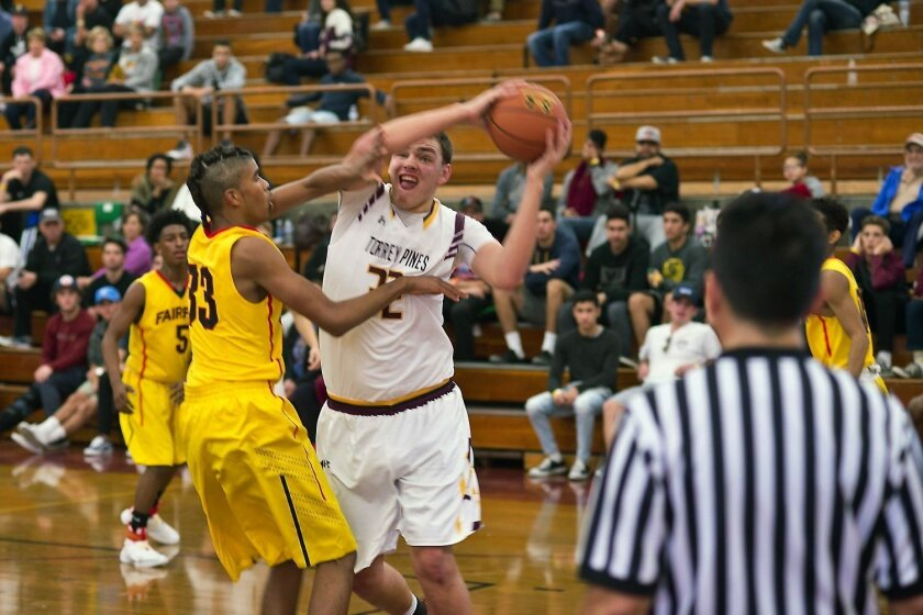 TPHS player Jake Gilliam (32) makes a move in the Dec. 27 game between the Falcons and Fairfax High School from Los Angeles. TPHS won 64-51.