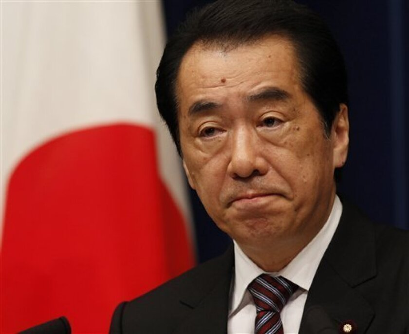 In this Aug. 26, 2011 photo, Japanese Prime Minister Naoto Kan pauses during a press conference in Tokyo, announcing his resignation to the nation. Japan's former prime minister says he feared early in the March nuclear crisis that it might become many times worse than the Chernobyl disaster and threaten the nation's survival in an interview with the Tokyo Shimbun daily published Tuesday, Sept. 6. (AP Photo/Koji Sasahara)