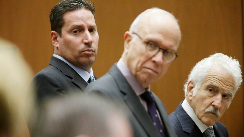Todd DeStefano, a former executive at the Los Angeles Memorial Coliseum, with by his attorneys Richard Hirsch, center, and Michael Nasatir, right, was sentenced to six months in jail.