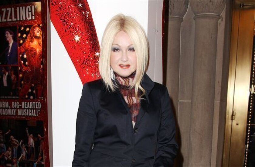 """This Feb. 28, 2013 photo released by Starpix shows, Cyndi Lauper at the open house for the Upcoming Musical """"Kinky Boots,"""" featuring Music by Cyndi Lauper, at the Al Hirshfeld Theatre in New York. (AP Photo/Starpix, Kristina Bumphrey)"""
