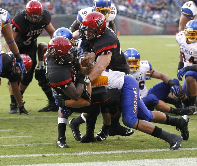 Aztecs running back Walter Kazee scores a 2nd quarter touchdown during the Aztecs football game against San Jose State Saturday night at Qualcomm Stadium.