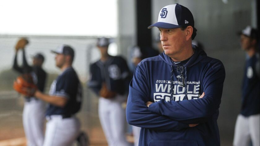 Padres pitching coach Darren Balsley watches a bullpen session at spring training.