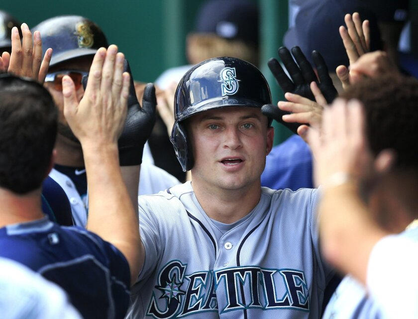 Seattle Mariners' Kyle Seager is congratulated by teammates after his three-run home run off Kansas City Royals starting pitcher Edinson Volquez during the fourth inning of a baseball game at Kauffman Stadium in Kansas City, Mo., Saturday, July 9, 2016. (AP Photo/Orlin Wagner)