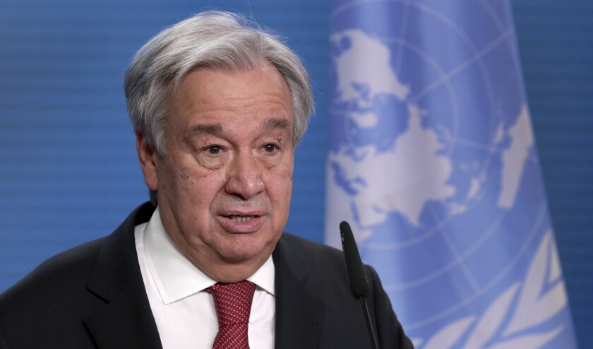 UN Secretary-General Antonio Guterres addresses the media during a joint press conference with German Foreign Minister Heiko Maas after a meeting in Berlin, Germany, Thursday, Dec. 17, 2020. (AP Photo/Michael Sohn, pool)