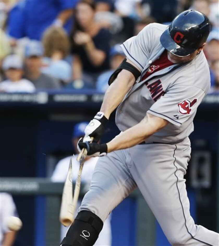 Cleveland Indians designated hitter Jason Giambi breaks his bat while grounding into a double play during the first inning of a baseball game against the Kansas City Royals at Kauffman Stadium in Kansas City, Mo., Tuesday, July 2, 2013. (AP Photo/Orlin Wagner)
